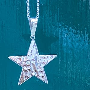 Hammered Star Pendant Outside on Green