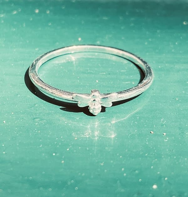 bee stacking ring on green