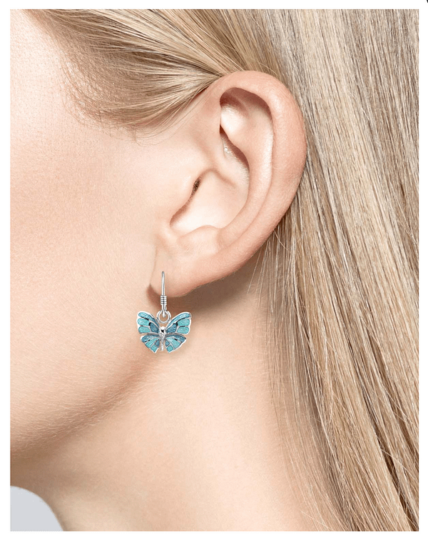 enamel butterfly drop earrings on model